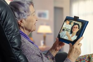 Elderly woman having a telehealth consultation